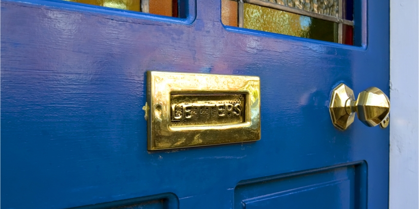 Close up of a blue front door and letterbox