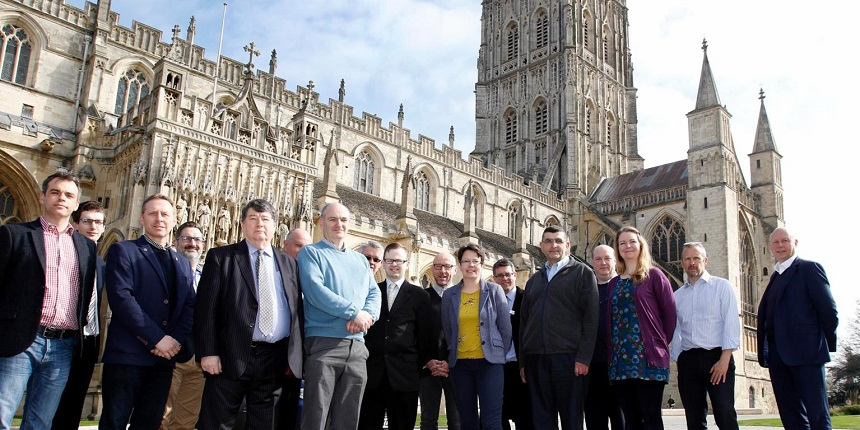 Delegates from a cathedral fire training session run by Ecclesiastical outside Gloucester Cathedral