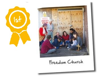 Freedom Church photo entry - a small congregation gather outside a church which is undergoing works