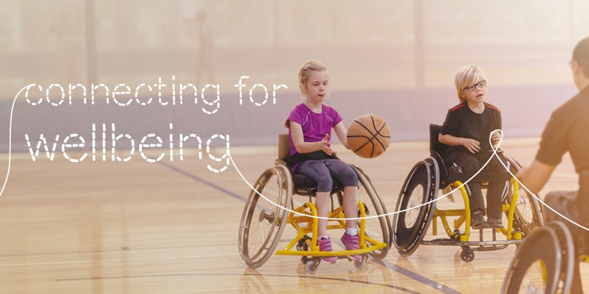 Children in wheelchairs playing basketball - connecting for wellbeing
