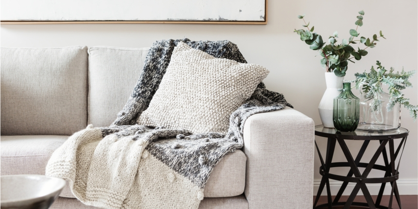 White sofa and blanket