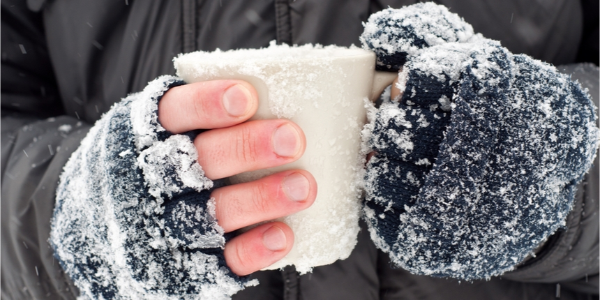 Icy hands wrapped in gloves
